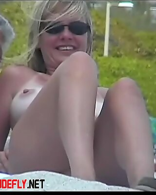 Naked tits proudly sticking for beach voyeur cam