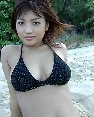 Celestial-looking junior Kana makes a photo album on the seashore.