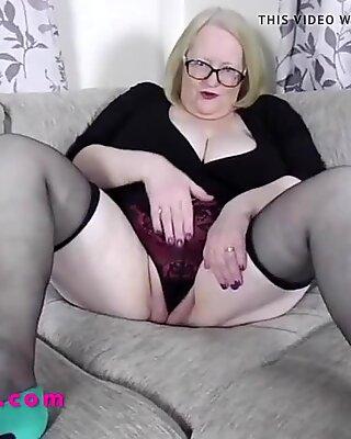Busty British Granny in a short skirt talks dirty