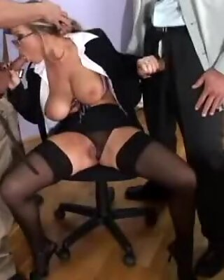 Jessica Moore gives a double blowjob to two rock hard cocks