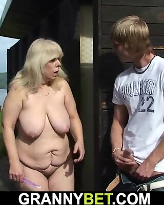 Guy fucks 70 years old blonde in the changing room