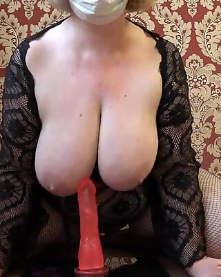 Mature plumper milks with a rubber bone in a cowgirl pose, appetizing booty shaking.