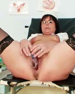 Old slut toys her pierced pussy on gynochair