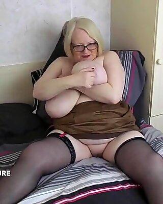 Love how her big tits hang below her halterneck top