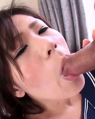 Yukari in her uniform gives titjob and blows hairy cock