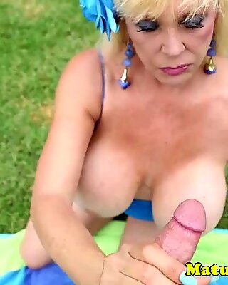 Granny jerks off guys dick outdoor