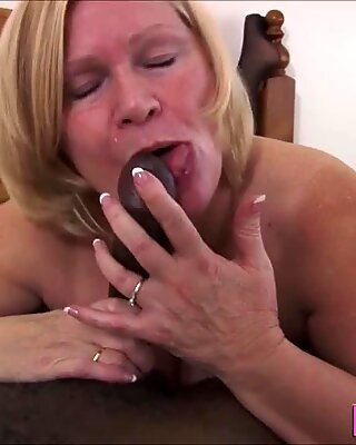 Granny in stockings gobbles and rides