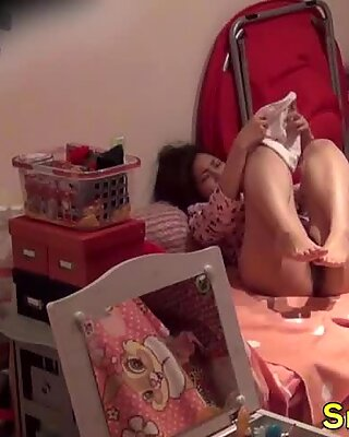 Japanese babe cums hard fingering her pussy