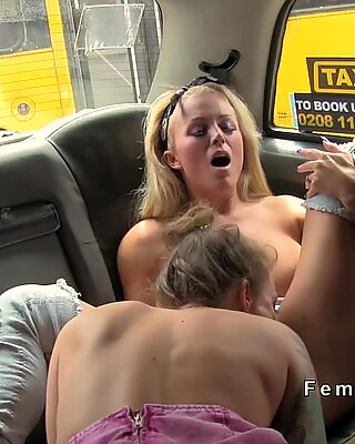 Blonde in thigh high boots in fake taxi
