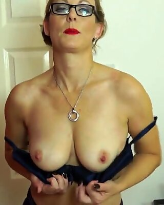 Naughty British mature woman playing with her wet pussy