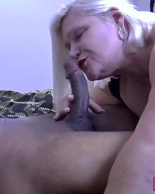 Gran gobbles black cock and gets fucked